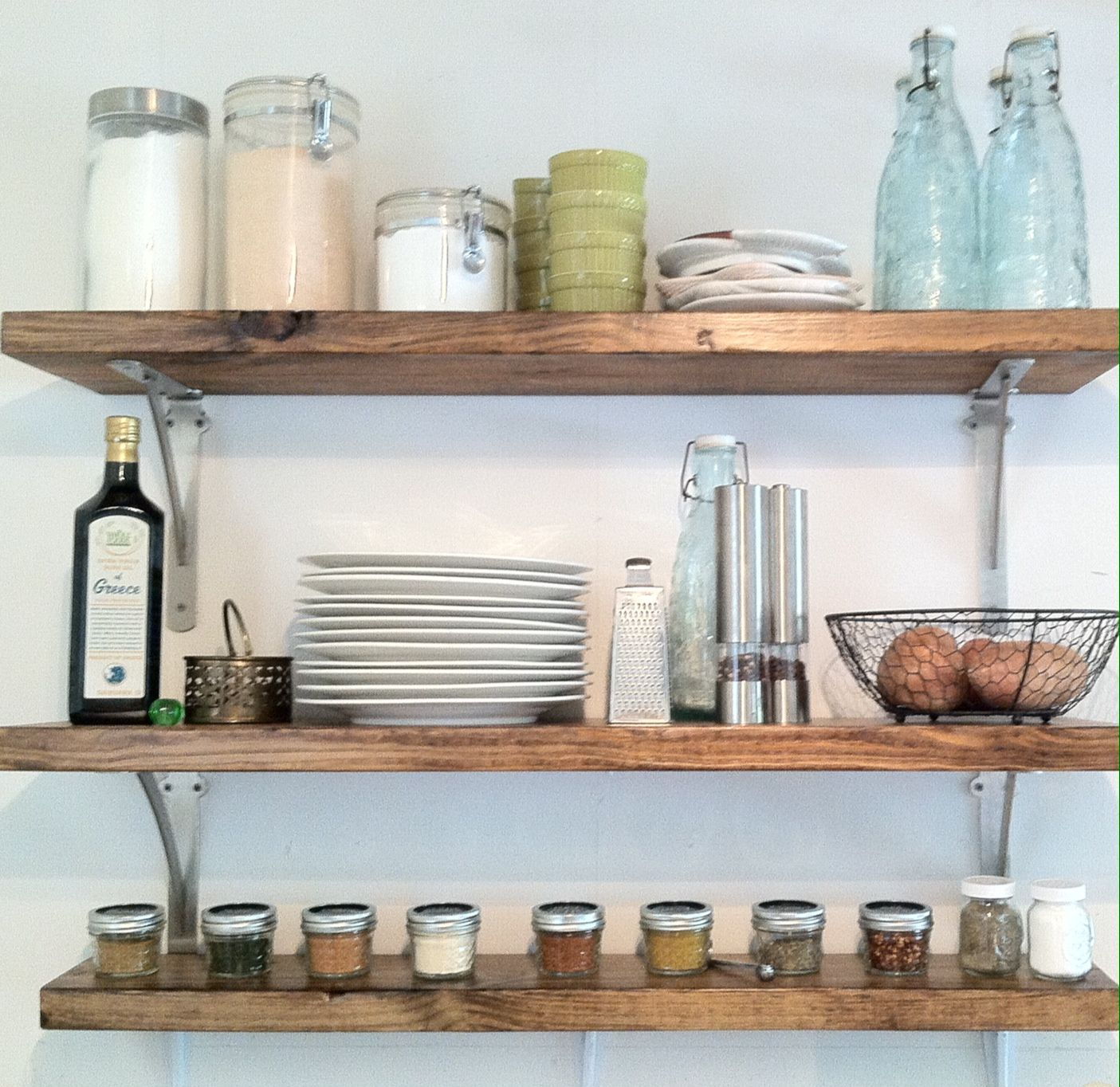 Diy rustic chic wooden kitchen shelves above stove. The tops of the mason  jars were
