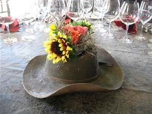 Country table center pieces pictures yahoo image search results use a cowboy hat as a vase for your reception table centerpiece flowers kinda cute maybe for gift table junglespirit Image collections