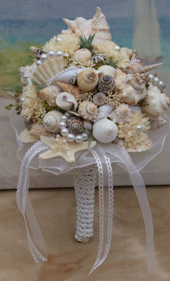 The Perfect Wedding Flowers For A Season Themed Wedding Seashell Wedding Bouquet Seashell Wedding Beach Wedding Bouquets