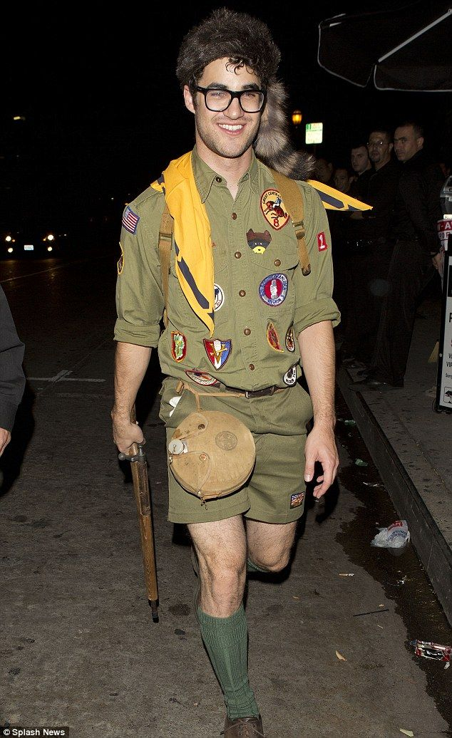 Going all out: Glee star Darren Criss went as a Boy Scout to the party,  complete with furry hat and rifle