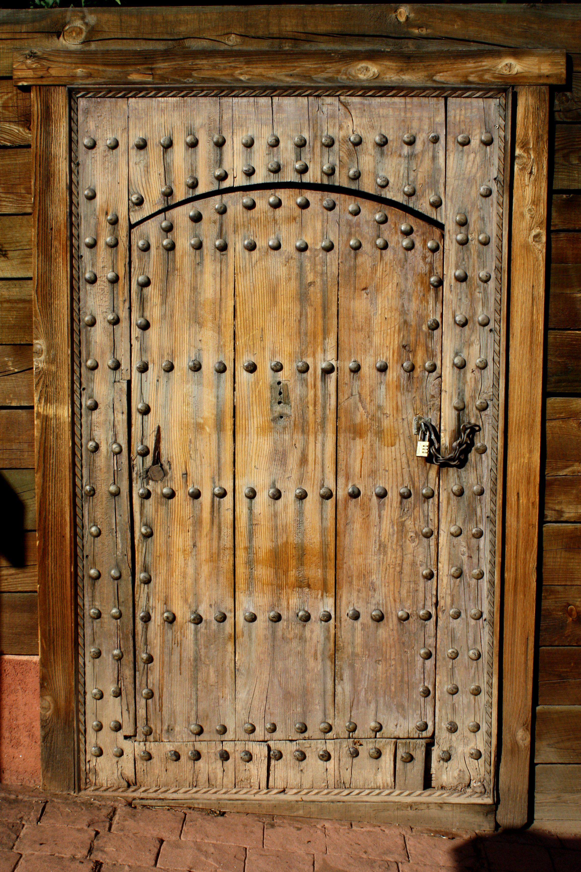 Old World Rustic Wooden Door with Bolts and Padlock