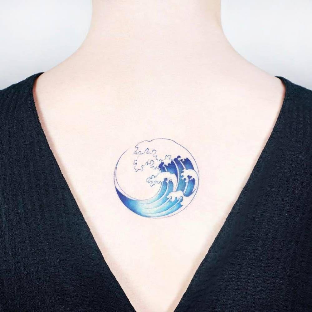 Wave Circle Tattoo On The Upper Back Tattoo Artist Ida Tattoos