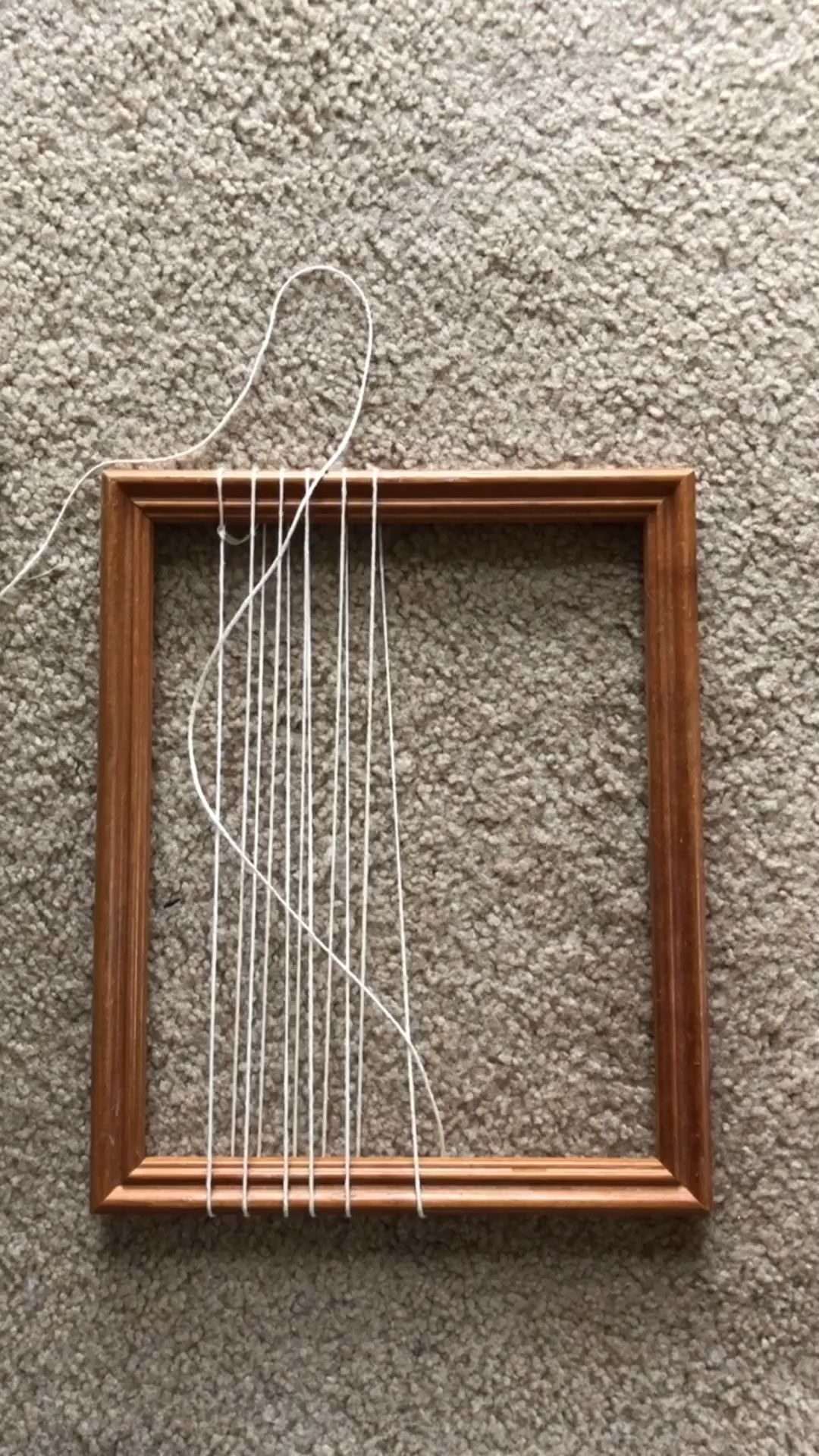 Weaving on a picture frame! Most people have one or two of these lying around. You can easily set one up to weave a tiny tapestry. This short vid shows you how to warp it (wind the string) and start weaving. I use a thick tapestry needle, cotton yarn/string for warping, chunky yarn for weaving, and a fork for packing down the rows nice and tight. ✨ .