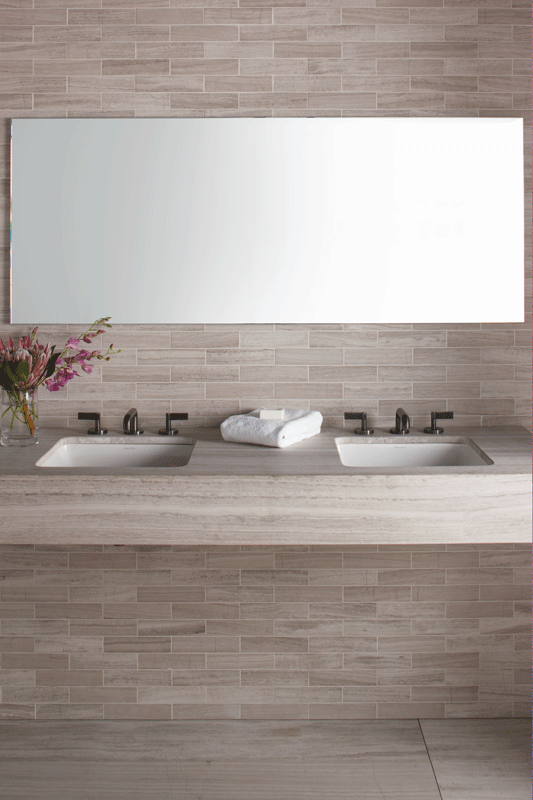 "ANN SACKS Athens Silver Cream 2"" x 8"" marble field and 30"" x 72"" marble slab countertop shown with KALLISTA® One basin set, lower spout and lever handles"