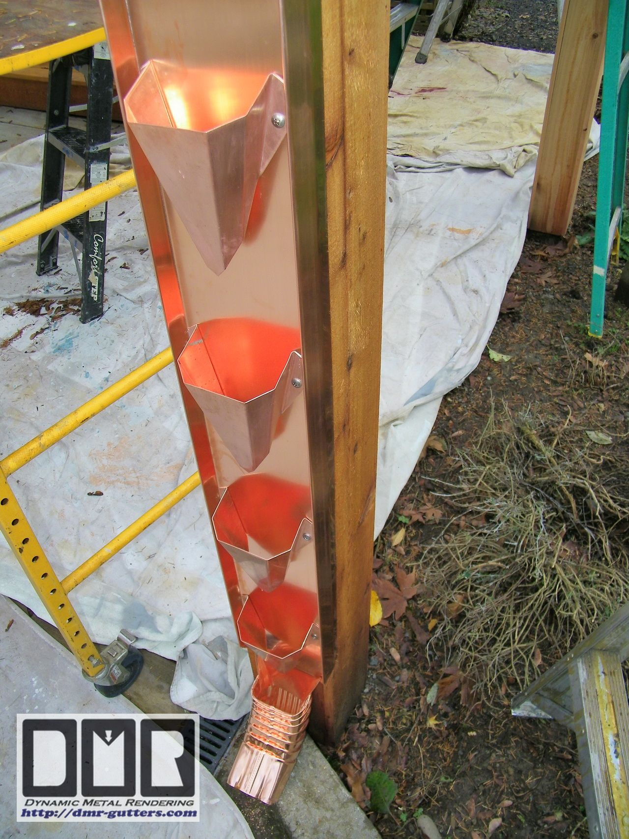 gutter system wall mount rain cups made with a 20oz copper back