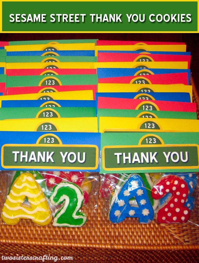 Frosted sugar Sesame Street Thank You Cookies make a great party-favor and thank-you gift for a Sesame Street Birthday party and are so easy to make. Follow us for more fun Sesame Street Party Ideas.