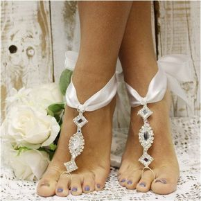 Add a little cosmopolitan glamour to your wedding or special occasion with our dramatic bow tie white ribbon and rhinestone barefoot sandals. A gorgeous accessory for a pair of heels or a black tie ev