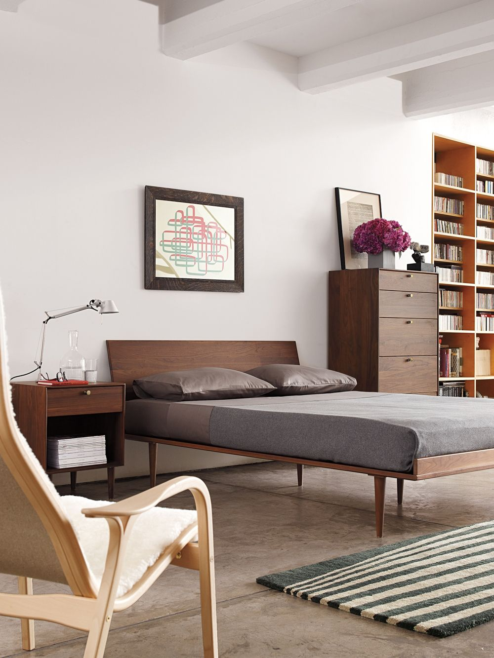 american modern bed in walnut designed by design within reach
