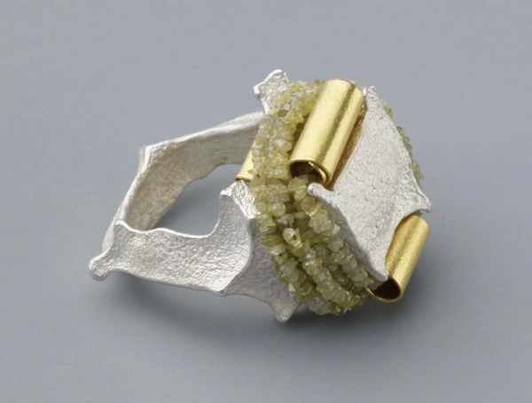 Johanna Dahm. 'Enhancement 8, 2012'. Silver and gold. Her Enhancement series uses the casting techniques of the African Ashanti and Indian Dokra. Pure silver rings are then decorated with pure gold, pearls or raw diamonds.