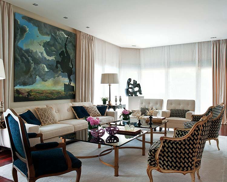 Paris Interior Design a large painting is the focal point of this stylish living room