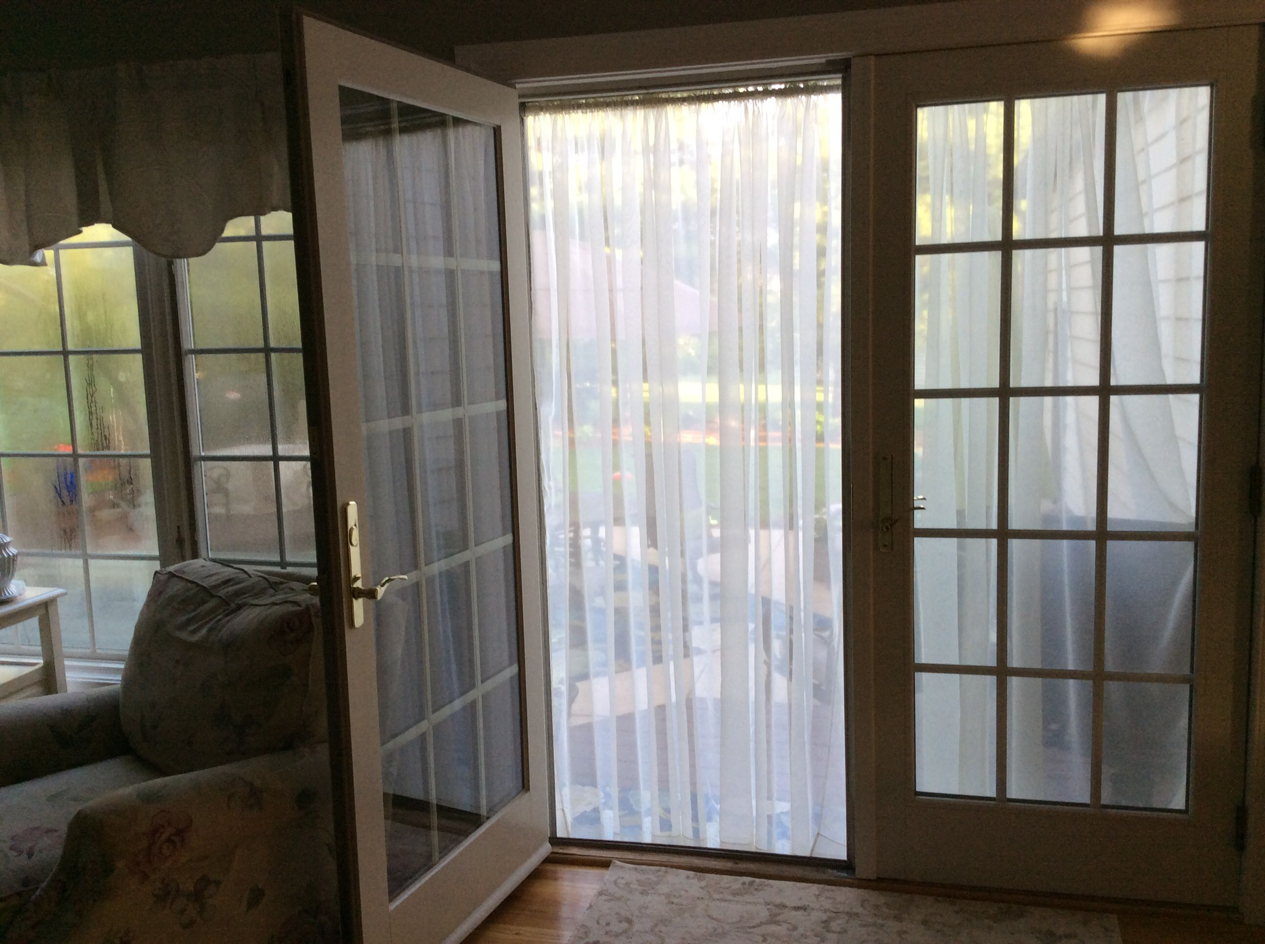 Outdoor Curtain On A Tension Rod Added To Patio Door Instead Of A