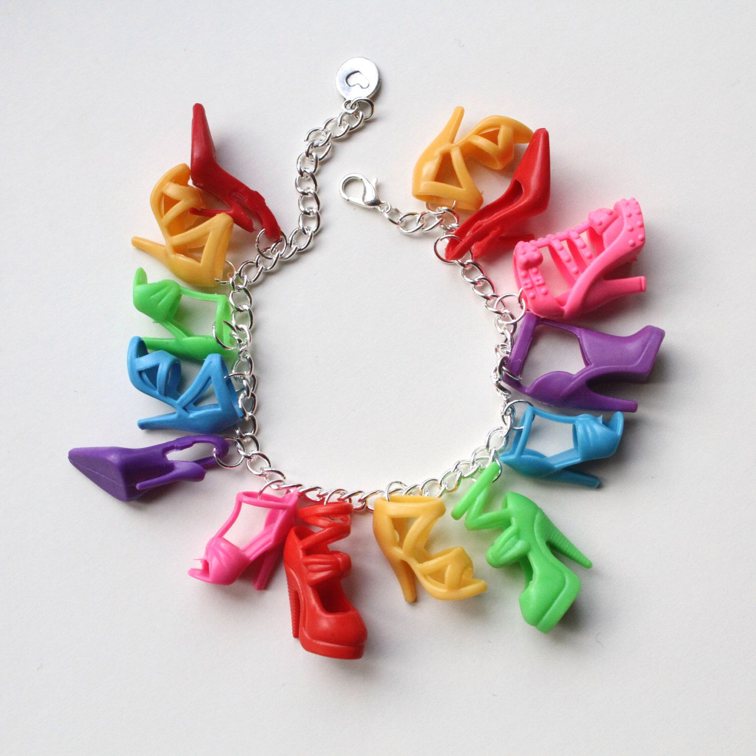 A personal favourite from my Etsy shop https://www.etsy.com/uk/listing/263128468/barbie-shoe-charm-bracelet-rainbow-doll