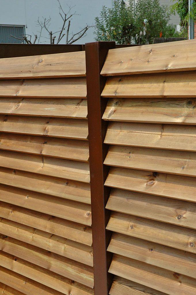 palissade en tubes d acier corten et bois clotures pinterest palissade bois et acier corten. Black Bedroom Furniture Sets. Home Design Ideas
