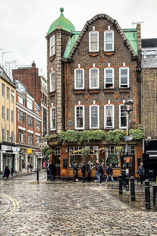 A pretty pub in Soho, London. This is a great area for a walk in London. Click through for more pictures on the A Lady in London blog.   #walks #london #soho #pub