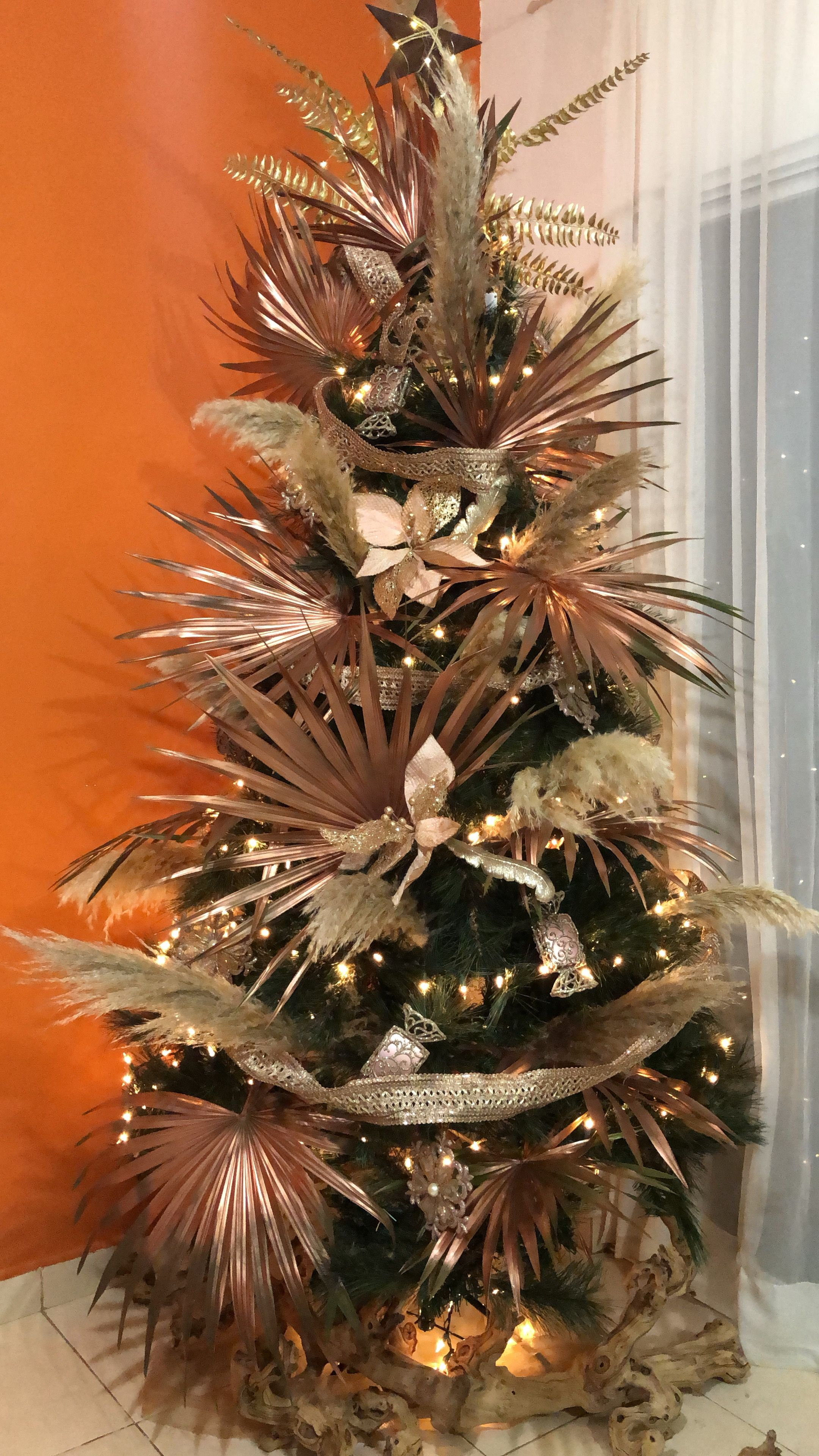 Pampas Grass And Palm Leaves Rose Gold Christmas Tree Design By Me For Our Beach Tropical Christmas Decorations Tropical Christmas Trees Christmas Palm Tree
