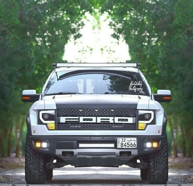 Ford f 150 svt raptor 62l v8 in white with custom led headlights ford svt raptor in white with custom led headlights and a light bar across the top of the windshield mozeypictures Images