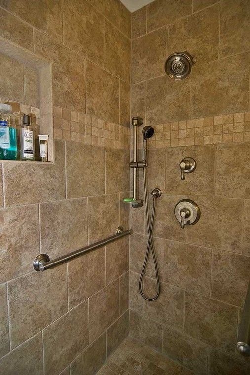The Grab Bars Coordinate With The Faucet Fixtures Including A