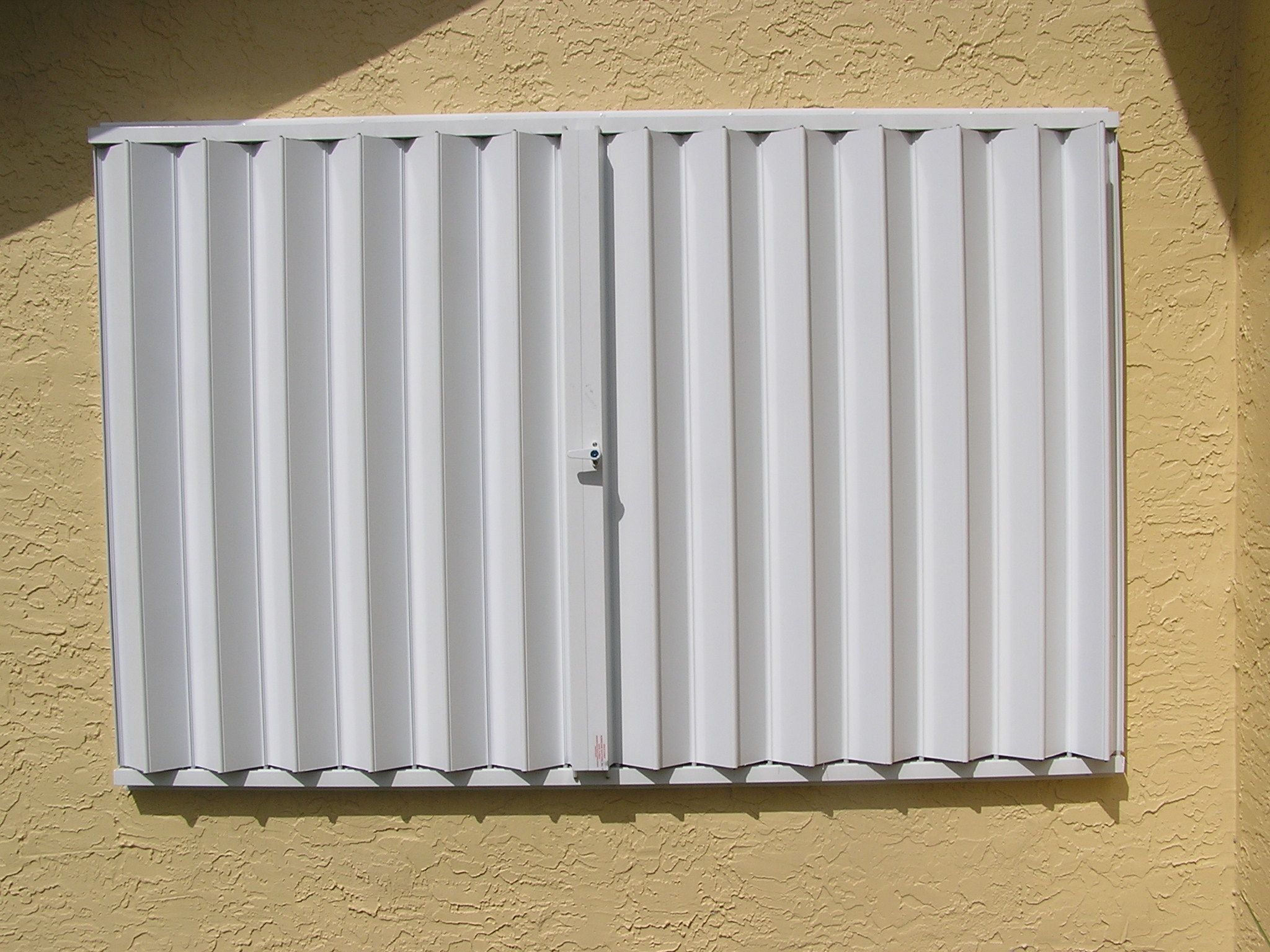 Accordion Hurricane Shutters Bertha Hv Accordion Shutters Ours Come With A 10 Year Warranty Shutters Red Shutters Hurricane Shutters