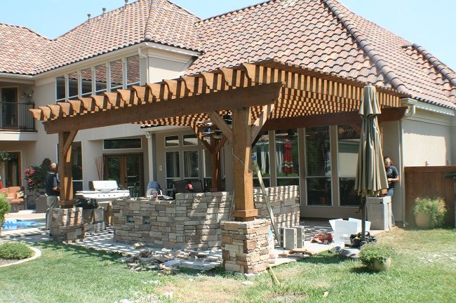 Pergola with rough cut wood and stones Google Search – Backyard Kitchens