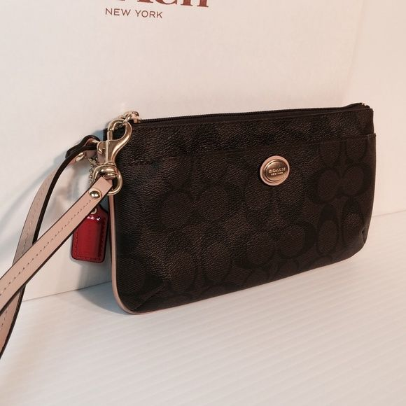 "NWT Coach Peyton Medium Wristlet New with tags.  Gorgeous brown signature wristlet. Medium size. Measures 8"" x 5"".  Multiple cc slots, and additional zip pocket on backside.  Will fit all sizes of cell phones, plus so much more!  No trades. Coach Bags Clutches & Wristlets"
