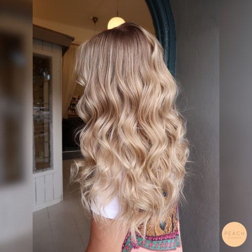 Photo of Long wavy blonde hairstyle for women
