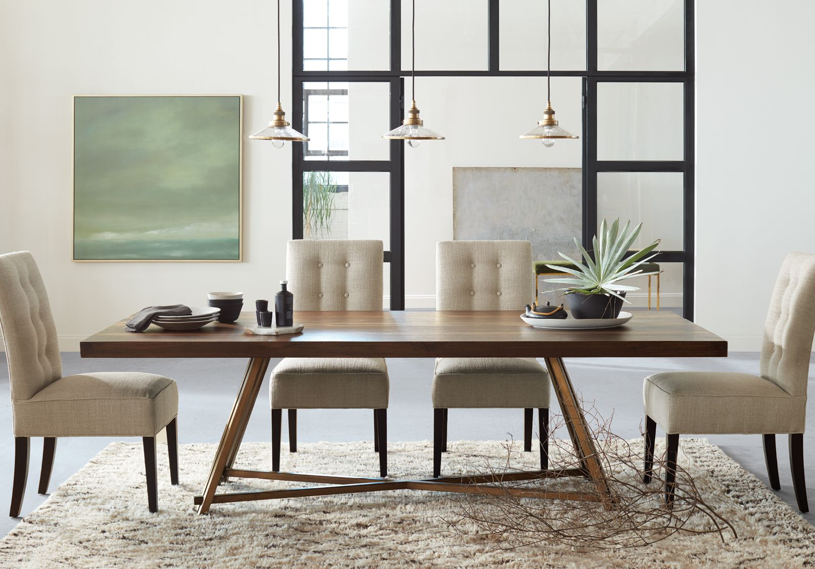 The Nika Dining Table Pairs Structured Lines With The Organic Beauty Of Reclaimed Wood Preser Brass Dining Table Dining Table Lighting Dining Table In Kitchen