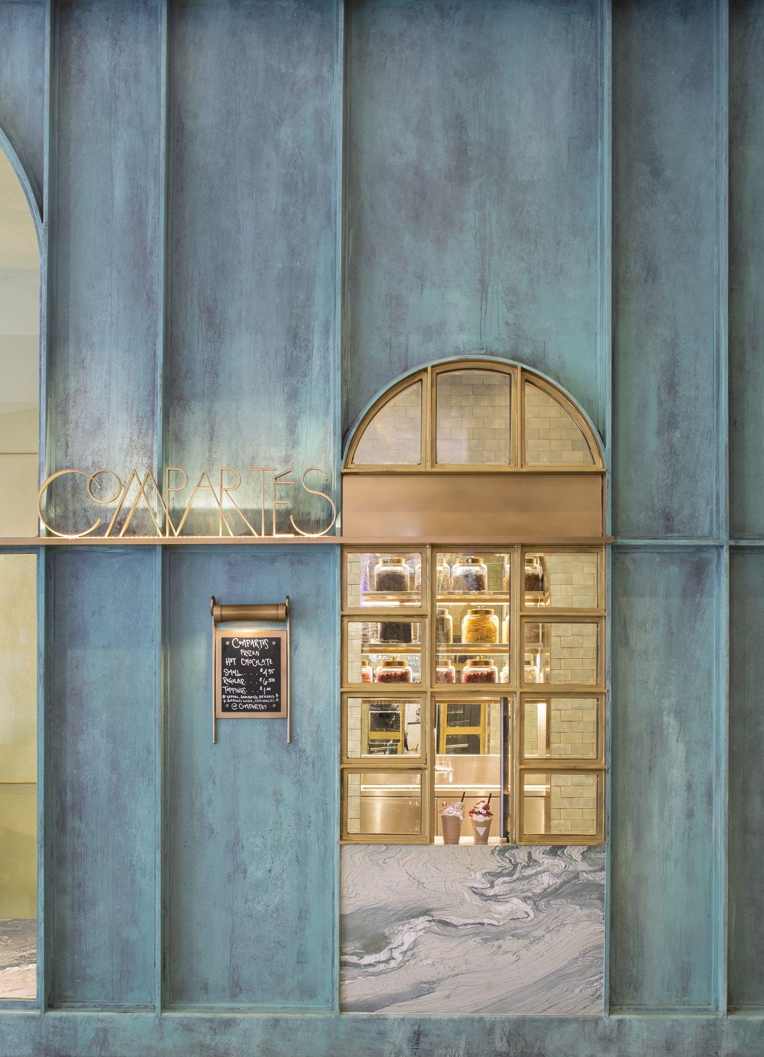 Compart s chocolate opens a dusky emerald flagship in los angeles restaurants and shops for Modern interior doors los angeles