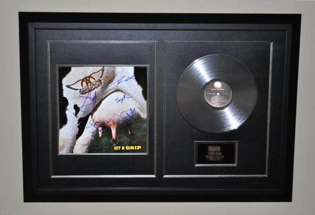 Aerosmith – Get A Grip -  Hand signed by: Steven Tyler – Joe Perry – Tom Hamilton – Brad Whitford – Joey Kramer. #aerosmith #musiccollectibles See the Collection: http://www.rockstargallery.net/framed-signed-albums