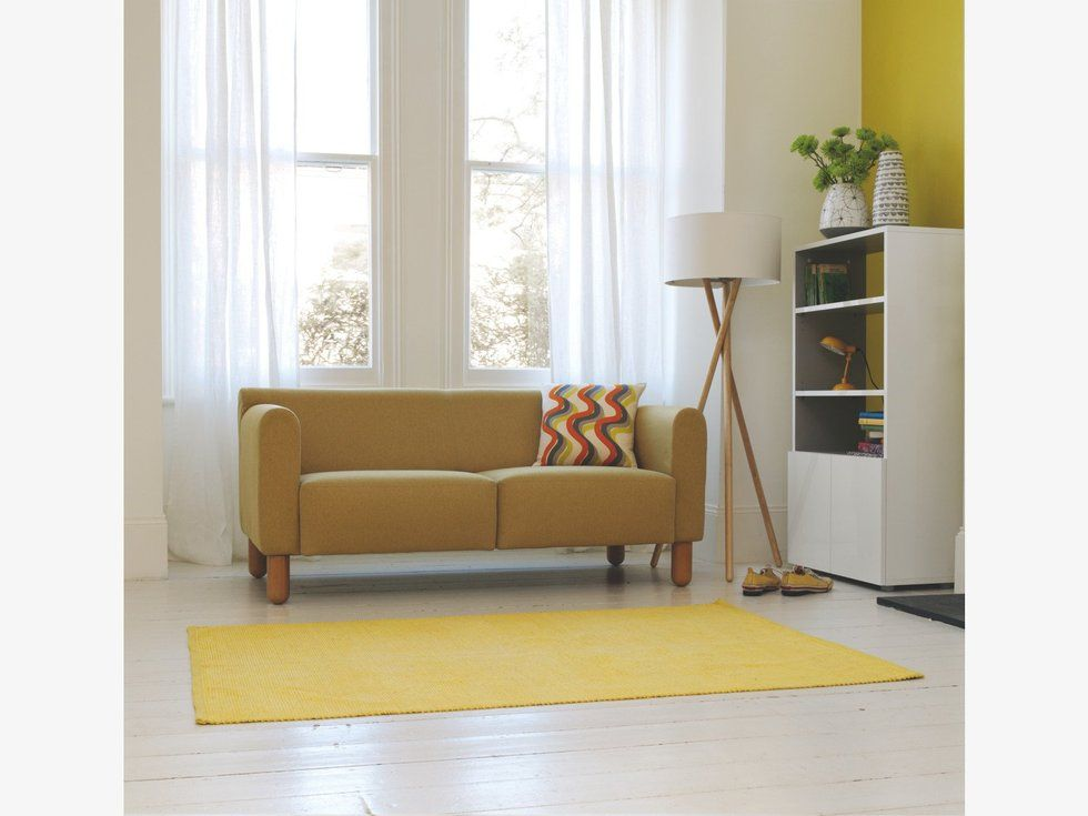 Small yellow cotton rug