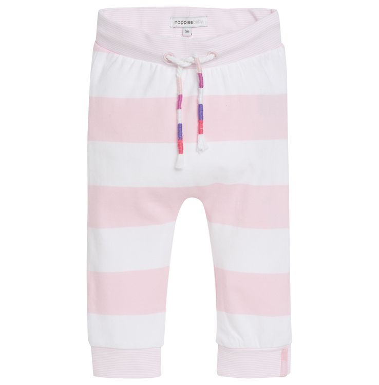 Girls' trousers Evy by Noppies. Made of 95% cotton and 5% elastane. The trousers have a striped print and an elastic drawstring band. The cuffs at the bottom of the trouser legs have a thin stripe and a snug fit. #noppies #babyfashion #girls #coolgirls #polkadots #ss15 #summer #spring #cutebaby www.noppies.com
