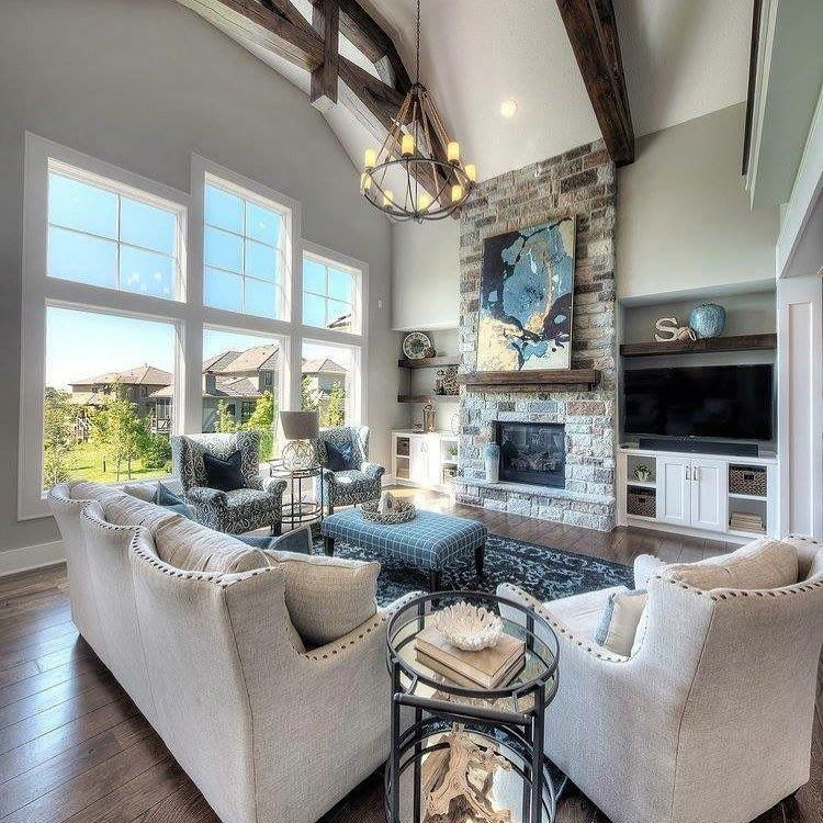 Raw Stone Fireplaces And Wood Beams Are Still Trending In New Builds Do You Love This Lo Family Living Room Design Living Room Decor Rustic Rustic Living Room