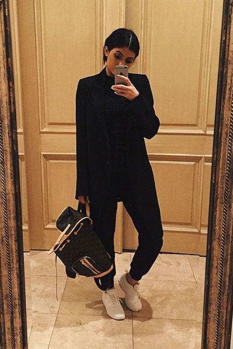 Kylie looks effortlessly edgy in a chic all-black outfit. We cannot get over that fab backpack!