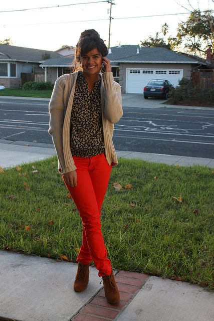 red pants patterned blouse, neutral sweater, suede bootie wedges