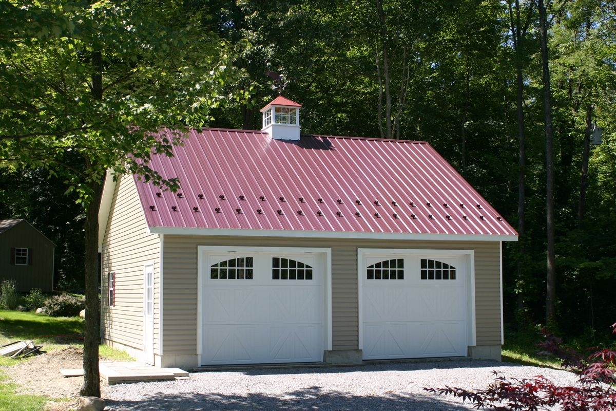 Two car garage with a lovely cupola see the fancy doors for Multi car garage