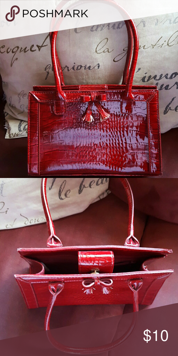 Liz claiborne purse Small red patent leather alligator print handbag. No scratches and in clean condition Liz Claiborne Bags Mini Bags