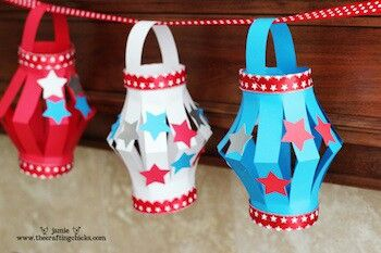 This was originally designed for the 4th of July. I'm going to spin it a little and do these lanterns in bright colors, add flowers and foam ladybugs to hang from my daughter's ceiling in front of her window. It will dress up her plain white blinds beautifully!