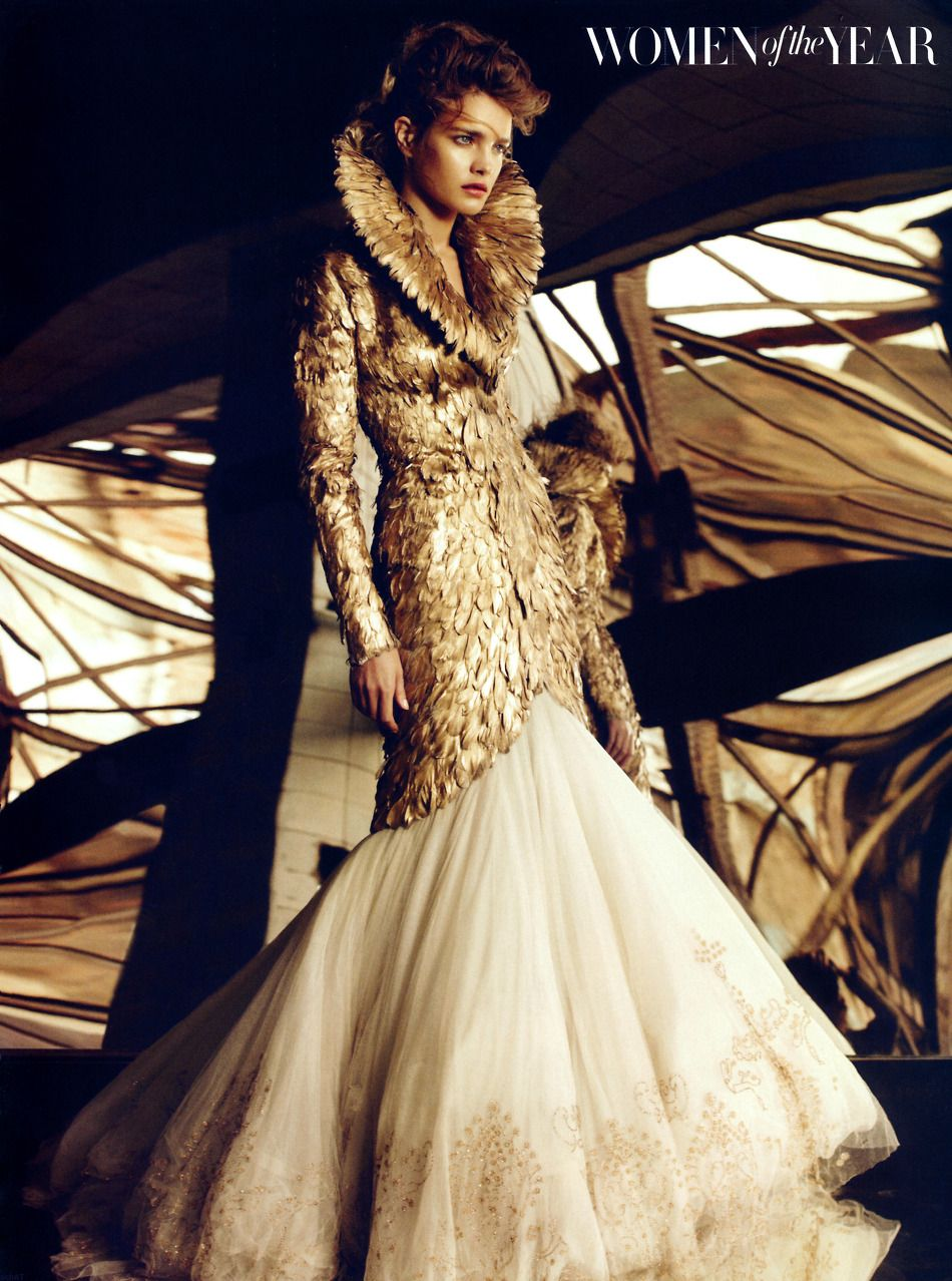 Highcollared long jacket handcrafted from gold feathers and worn