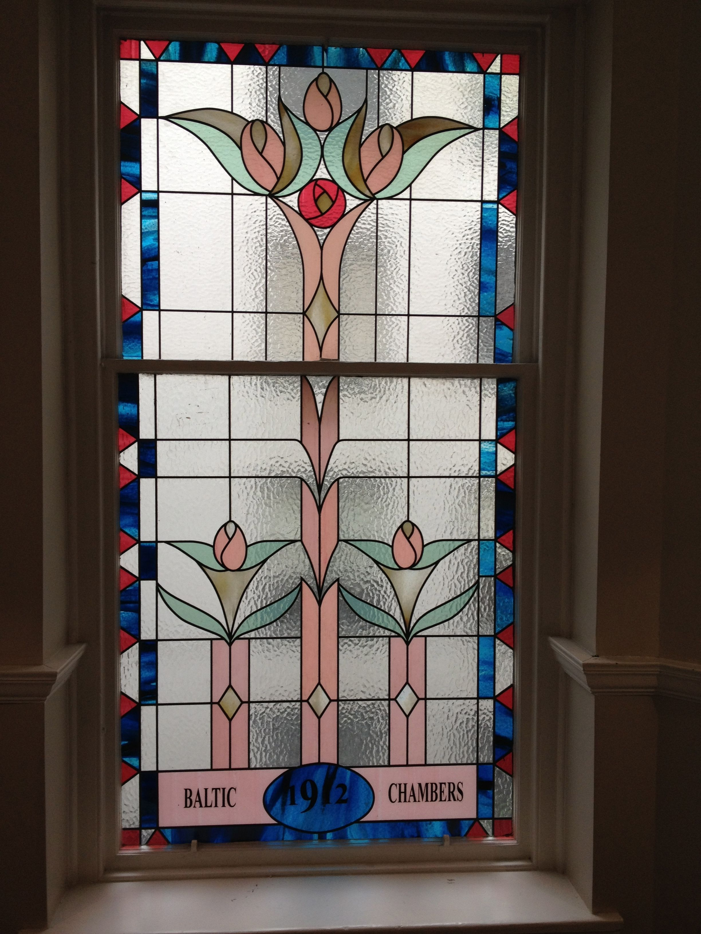 Beautiful stained glass window in the entrance to a glasgow clientus