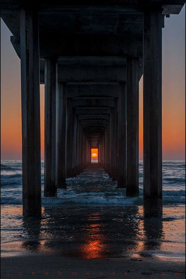 This special photo can only be taken twice per year.  Sunset at Scripps Pier, La Jolla CA
