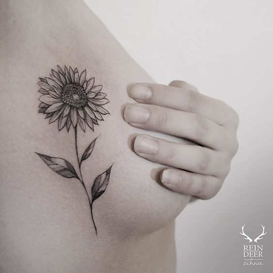 Placement fancy sunflower side boob tattoo pierce n for Side boob tattoo ideas