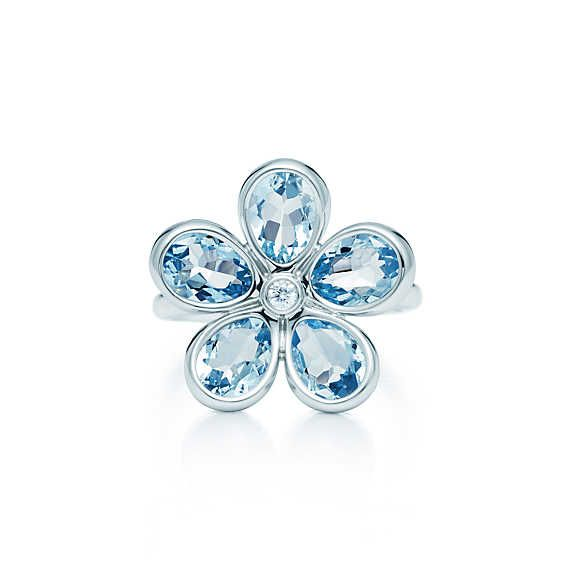 Tiffany Sparklers flower ring in 18k white gold with aquamarines and a diamond.   Tiffany & Co.