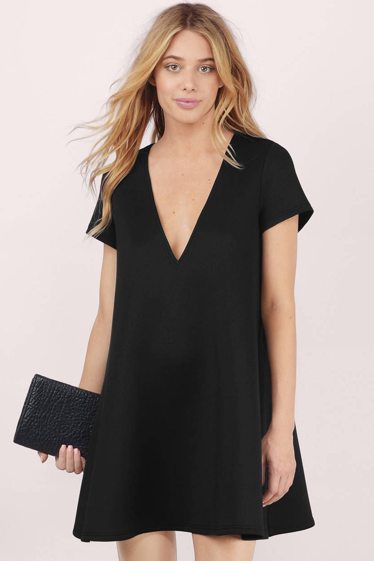 a1cfb2da12 Short sleeve shift dress with deep plunge V neckline. Wear with chic high  heels for a casual evening out. Available in black and cobalt.