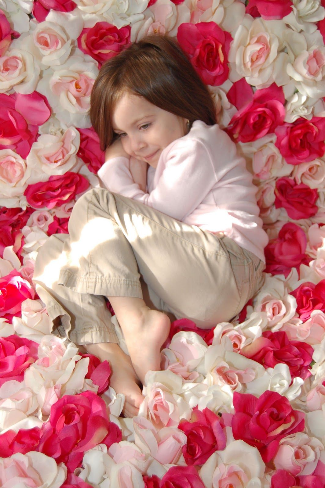 Silk flowers sewn or hot glued onto fabric  the Flower Blanket that is used for baby girl