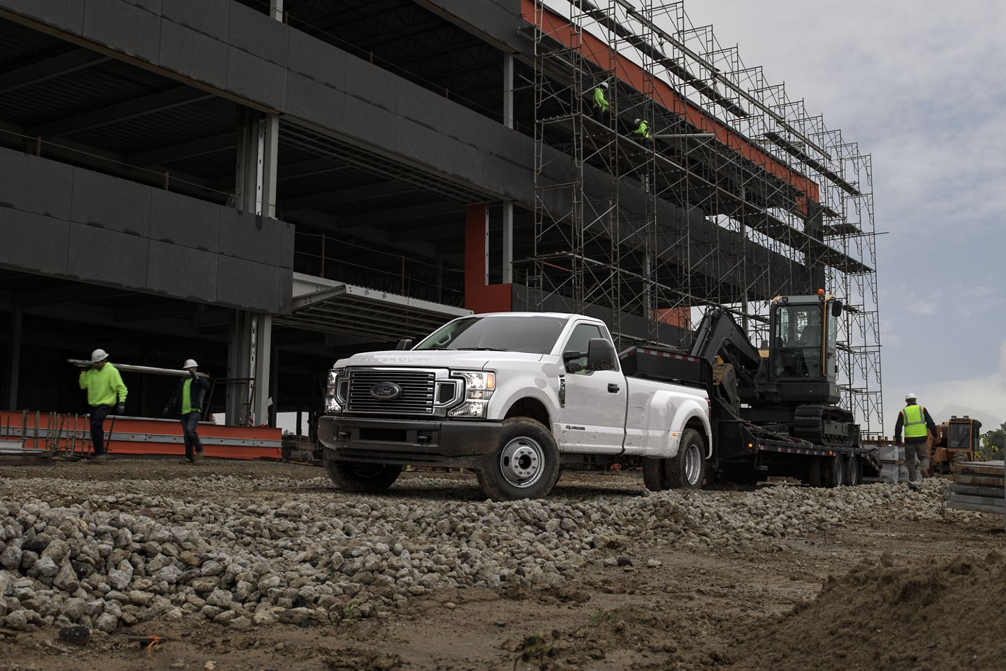 A 2020 Super Duty Tows A Piece Of Heavy Machinery On A