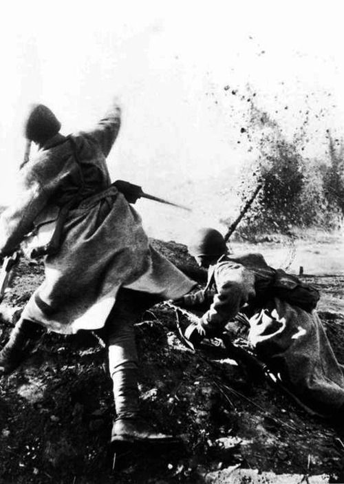 A Soviet soldier throws a grenade, 1943.  Dmitry Baltermants