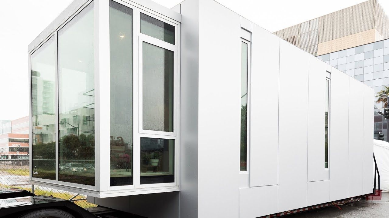 Stunning White Modular Home Inspired by Dumpster Living | Le Tuan ...