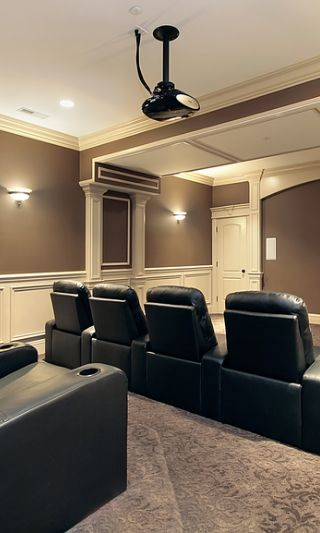 large stadium seating in luxury home theater and media room home
