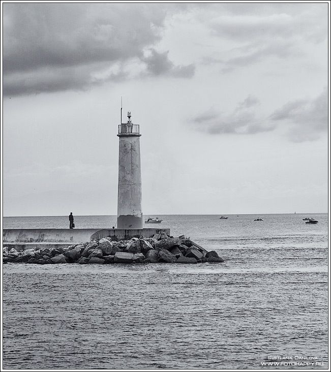Lighthouse at Rocky Shore with Boat, Istanbul/Turkey