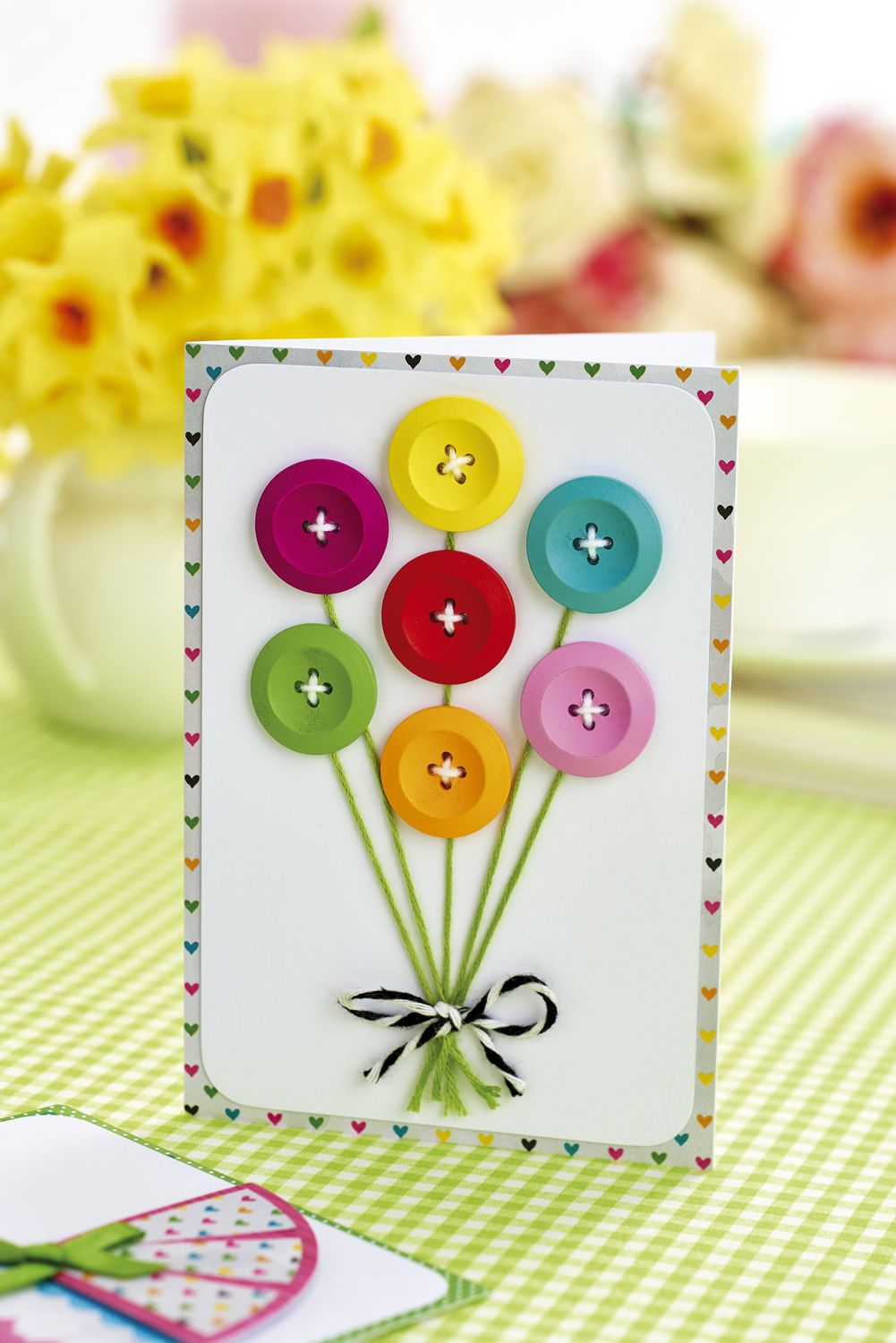 Make cards featuring buttons in our April issue, out now! Pic