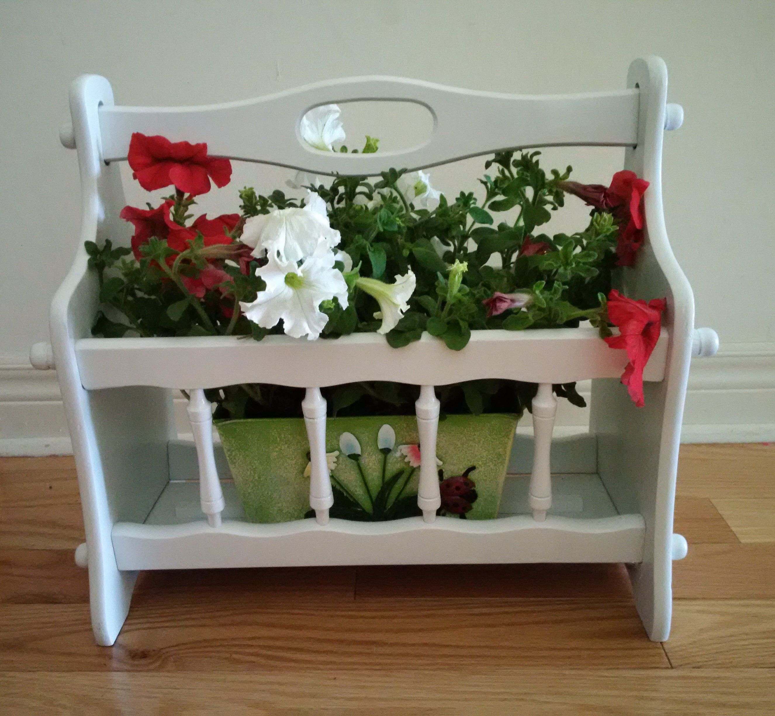 painted an old wood magazine rack and reused it as an outdoor flower planter
